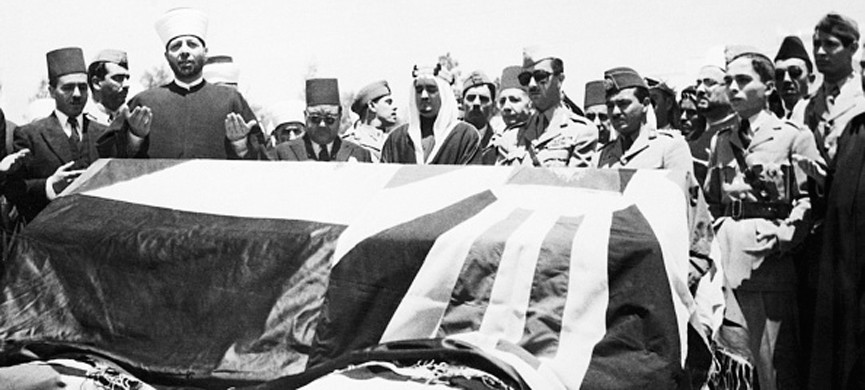 (Original Caption) 7/29/1951-Amman, Jordan- Members of the royal family are shown standing behind the flag-draped coffin of assassinated King Abdullah of Jordan, as prayers are offered before burial, in the royal cemetery at Amman. From left to right are: behind coffin, Prince Abdullah, Iraq regent; Prince Naif, 35-year-old brother of Prince Talal, who was chosen by the cabinet to secede the late King and whose appointment made Prince Talal furious; Prince Houssein, son of Prince Talal and Prince Fahed of Saudi Arabia.