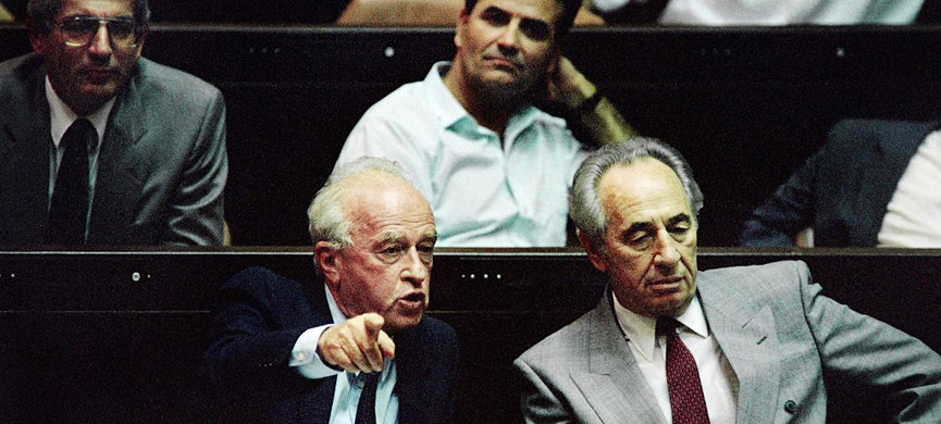 Israeli Prime Minister Yitzhak Rabin (L), sitting next to his Foreign Minister Shimon Peres (R), points at the Likud during an argument during the presentation of his government at the opening session of the Knesset on July 13, 1992. AFP PHOTO PATRICK BAZ / AFP / PATRICK BAZ (Photo credit should read PATRICK BAZ/AFP/Getty Images)
