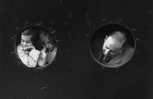 <p>17th June 1939: German Jewish refugees, looking through portholes aboard the Hamburg-Amerika liner 'St Louis' on arrival at Antwerp, where a temporary home was found for the 900 refugees aboard. Most were later deported. (Photo by Gerry Cranham/Fox Photos/Getty Images)</p>