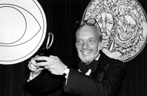 <p>Harold Prince poses with his Tony Award for best direction of a musical in 1980. He earned the honor for his work on <em>Evita.</em></p>