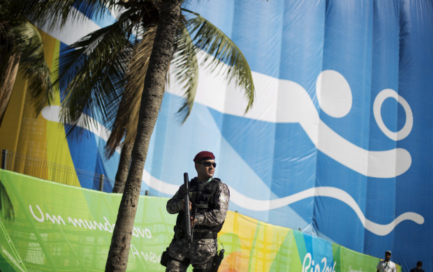 <p>A National Security Force officer patrols outside the beach volleyball arena along Copacabana Beach ahead of the upcoming 2016 Summer Olympics in Rio de Janeiro, Brazil, Tuesday, Aug. 2, 2016. (AP Photo/David Goldman)</p>