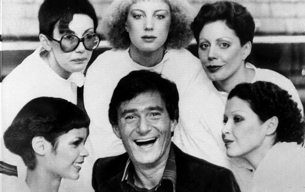 <p>Hairstylist Vidal Sassoon is surrounded by models, showing his new cuts for 1976, in London, on Jan.23, 1976. The styles are called, clockwise from lower left; The Hummingbird, Question Mark, Feathers, Tomboy and Silver Lady. (AP Photo)</p>