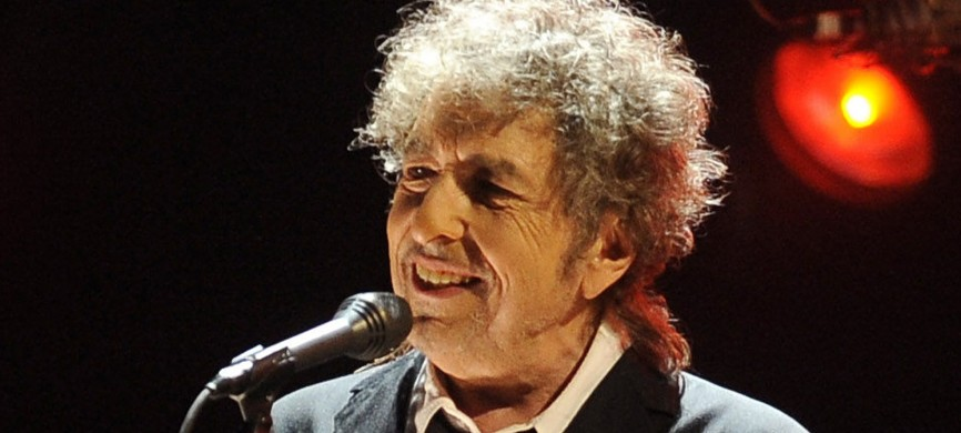 <p>FILE - In this Jan. 12, 2012 file photo, Bob Dylan performs in Los Angeles. Fifty years into his career as a recording artist and a week away from release of an extraordinary new CD, Dylan spent his Tuesday evening where he seems to feel most comfortable � on a stage. (AP Photo/Chris Pizzello, File) NYTCREDIT: Chris Pizzello/Associated Press</p>