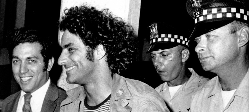 <p>Abbie Hoffman, leader of the Youth International Party known as the Yippies, is escorted by police after his arrest at O'Hare Field in Chicago upon his arrival from New York on Sept. 17, 1968. He was sought for not appearing in court on Sept. 6 to answer charges of disorderly conduct and resisting arrest. Police said a switchblade knife and a knife with a four-inch blade was found on Hoffman, who was then booked on charges of unlawful use of weapon. At left is his attorney Gerald B. Lafcourt. (AP Photo)</p>